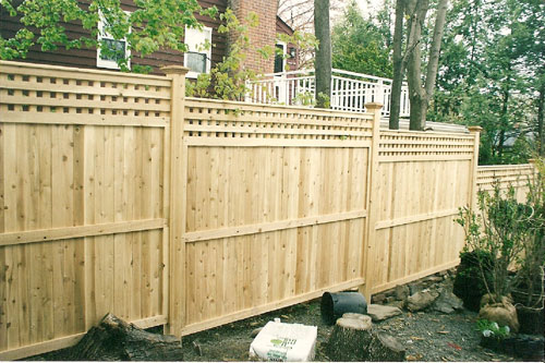 Pre-made wood panel fence with lattice