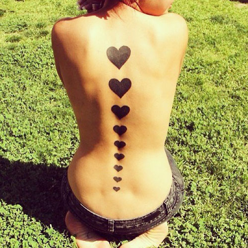 Heart Tattoo Ideas - Hearts down spine - Unique Tattoos