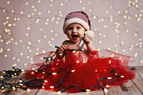Baby Christmas Picture Ideas - Baby Playing with Christmas Lights
