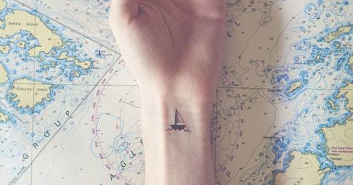 Tiny Wrist Tattoo - Small Boat Tattoo
