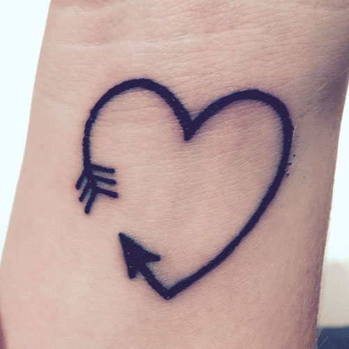 Simple Heart Arrow Tattoo On Wrist