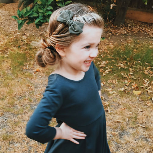 Little Girl Hairstyles - Cute Hairstyle Side Twist Low Bun